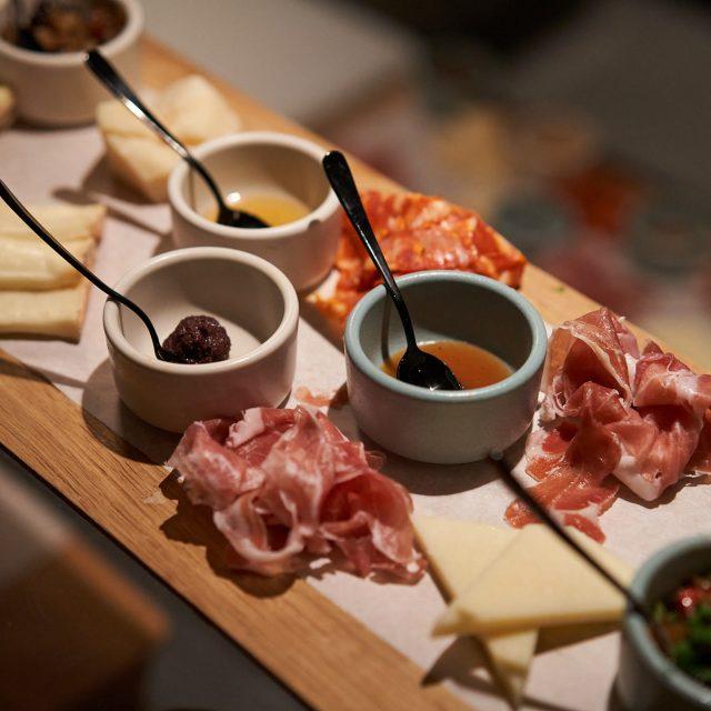 French Glamour & Sardinia Sights Charcuterie board at Extra Virgin Italian restaurant
