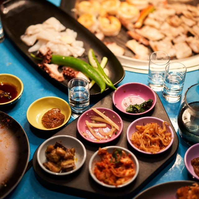 French Glamour & Sardinia Sights Food on the in-table grill at Gunbae Korean BBQ.