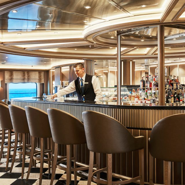 World Cruise with Silversea A bartender serving a cappuccino in The Bar.