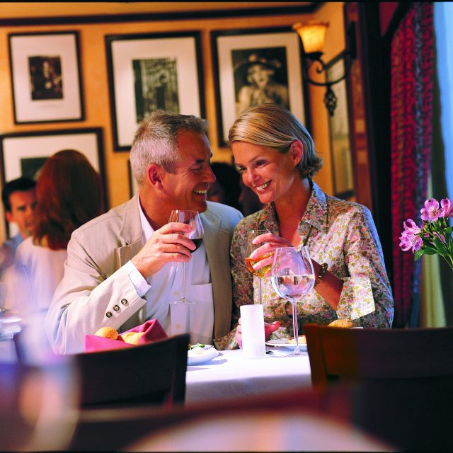 New York to Barcelona Senior couple dining in Cagney's
