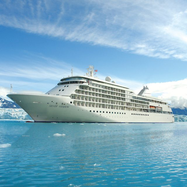 World Cruise with Silversea Silver Shadow cruising nearby a glacier.